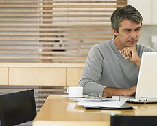 man-in-sweater-looking-at-laptop-mt2015.