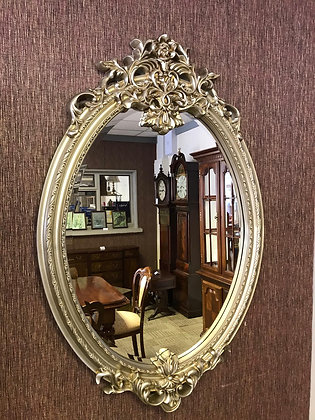 Ornate oval rose gold mirror