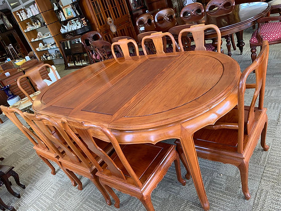 A solid wood oriental mahogany table with eight chairs