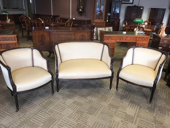 Victorian mahogany seating set with carving on castors, cream fabric