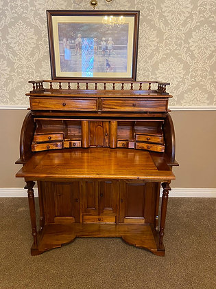 Solid mahogany cylinder writing bureau with pull out tray & gallery on top