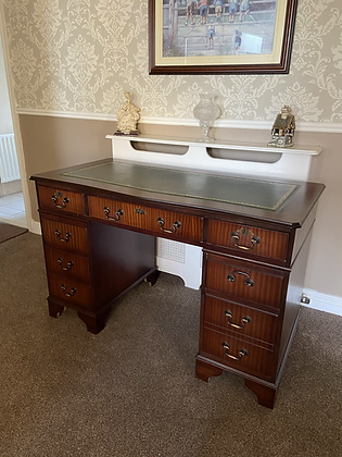 Mahogany bow front writing desk with green leather top