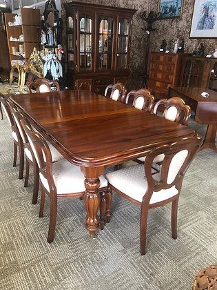 Mahogany extendable square end table and 8 chairs.