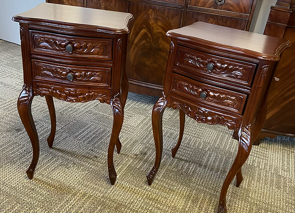 A pair of French two drawer dark mahogany bedside tables