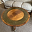 Thumbnail: Mahogany round occasional table with green leather top on caster wheels