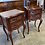 Thumbnail: A pair of French two drawer dark mahogany bedside tables