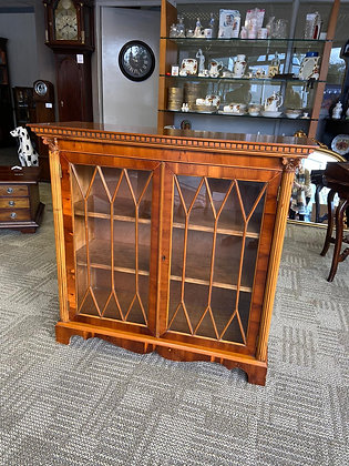 Walnut burdisplay cabinet with two wooden shelves & glass front