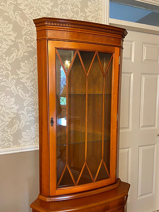 Yew corner cabinet with 2 glass shelves & lower cupboard