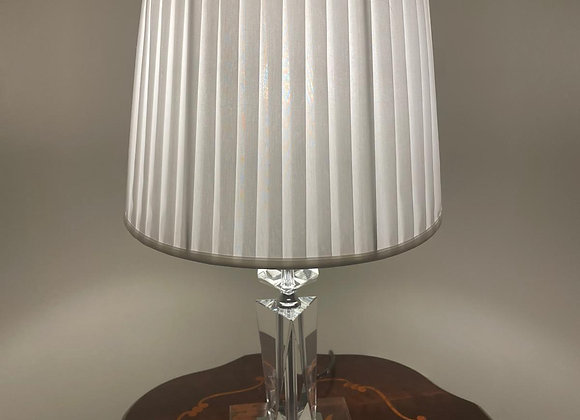 A stunning crystal lamp with a white lamp shade