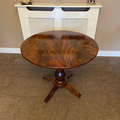 Solid mahogany flamed centre piece table (A)