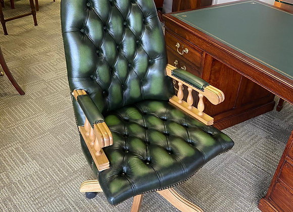Green chesterfield button directors chair on pine wood on wheels