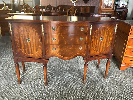 Mahogany flame sideboard with gold leaf decoration