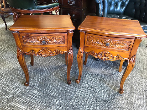 A pair of French one drawer golden mahogany bedside tables