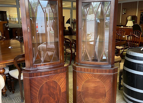 A pair of mahogany corner units