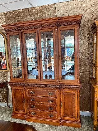 Mahogany inlaid display cabinet with lights.
