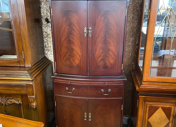 Mahogany drinks cabinet with a light