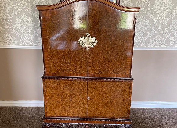 Walnut burr drinks cabinet with arched top on cabriole legs & lights