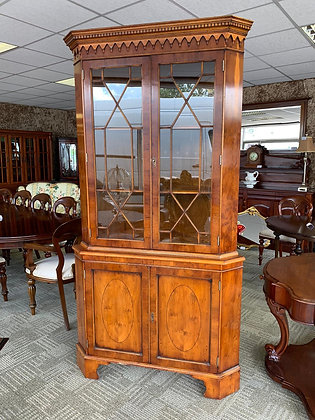 A large mahogany corner unit