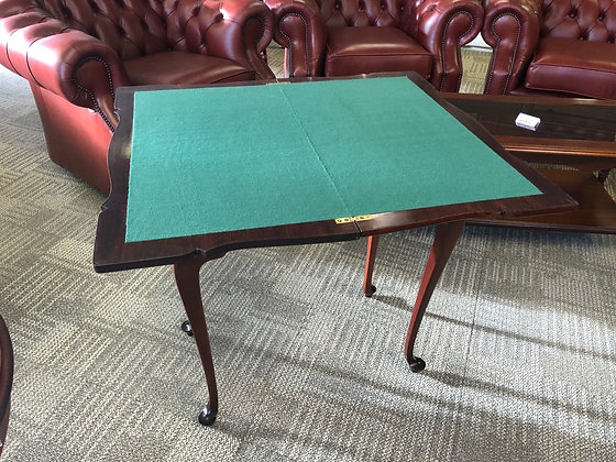 Mahogany games table on cabriole legs