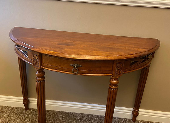 Solid console table with carved edging