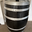 Thumbnail: Black bar barrell with silver bands on caster wheels