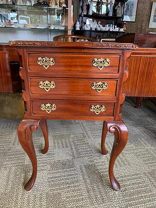 Mahogany side table on cabriole feet