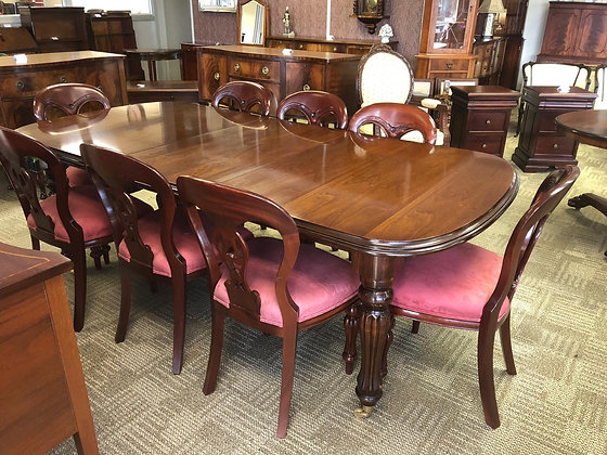 Mahogany extendable d-end table with 8 red material chairs