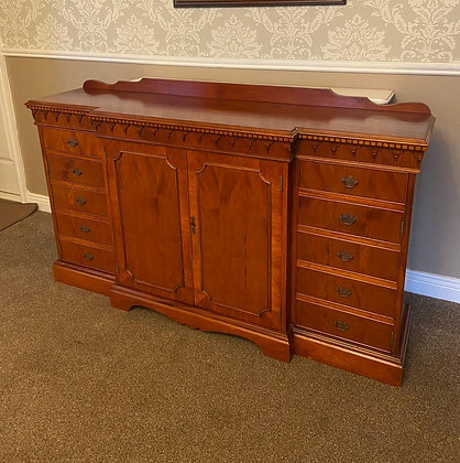 Dark yew breakfront sideboard with 10 drawers & cupboard