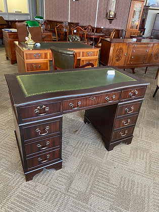 Mahogany bow front twin pedestal desk with green leather top