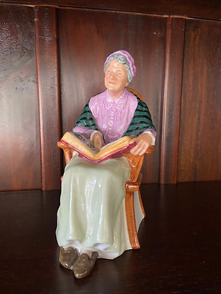 """Royal Doulton figurine is called """"The Family Album"""""""