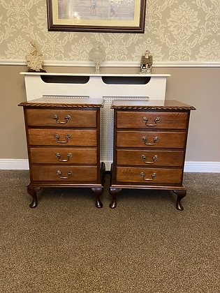 A pair of solidmahogany bedside lockers with 4 drawers