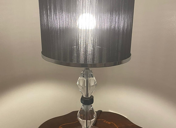 A stunning black and clear crystal lamp with a black lamp shade