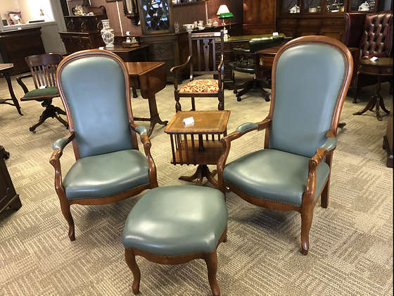A pair of antique style country house library fireside armchairs
