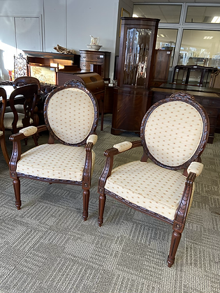 Open armchairs,carved mahogany with foliagespotted upholstered seat and back