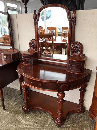 An Edwardian mahogany bow fronted dressing table with tapered legs