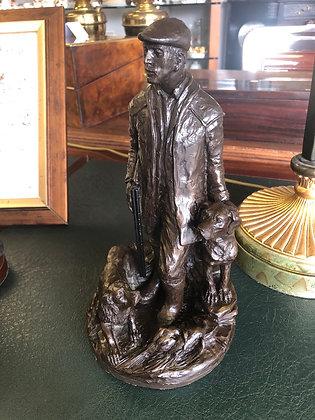 Genesis Bronze figure of Hunter and 2 dogs.