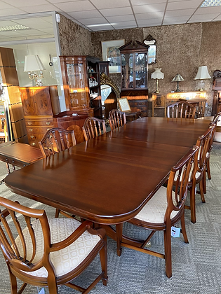 Mahogany extendable d-end table with 8 pattern material chairs