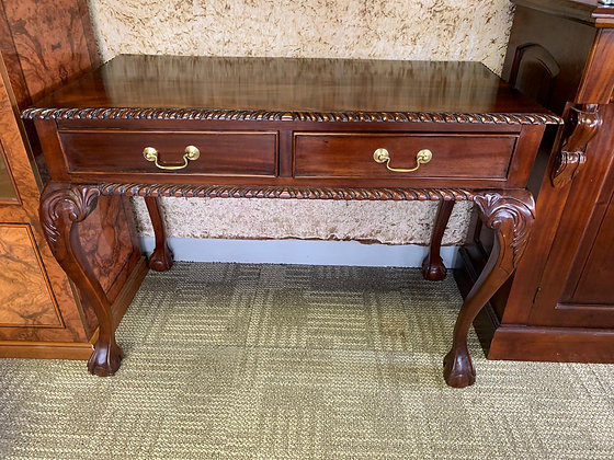 Chippendale style writing desk with two drawers.
