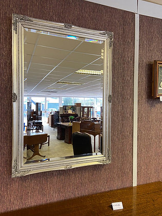 Silver rectangle shaped mirror with detailed edging