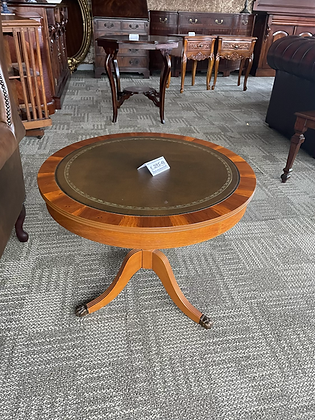 Yew drum table with creamy brown leather top