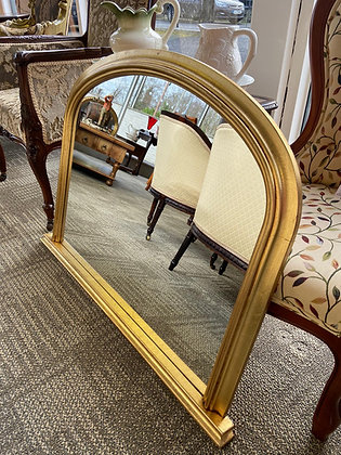 Narrow gold arched top mantle mirror