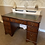 Thumbnail: Mahogany bow front writing desk with green leather top