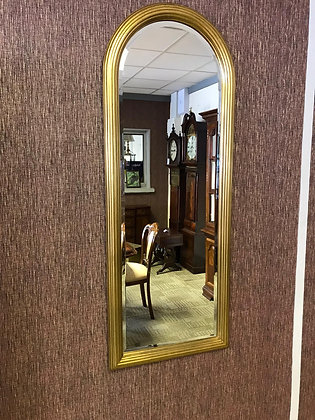 Tall narrow arched gold mirror