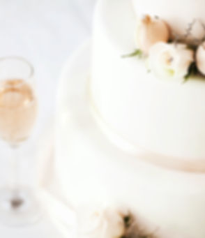 Wedding%20Cake%20And%20Champagne%20Flutes%20On%20Table_edited.jpg