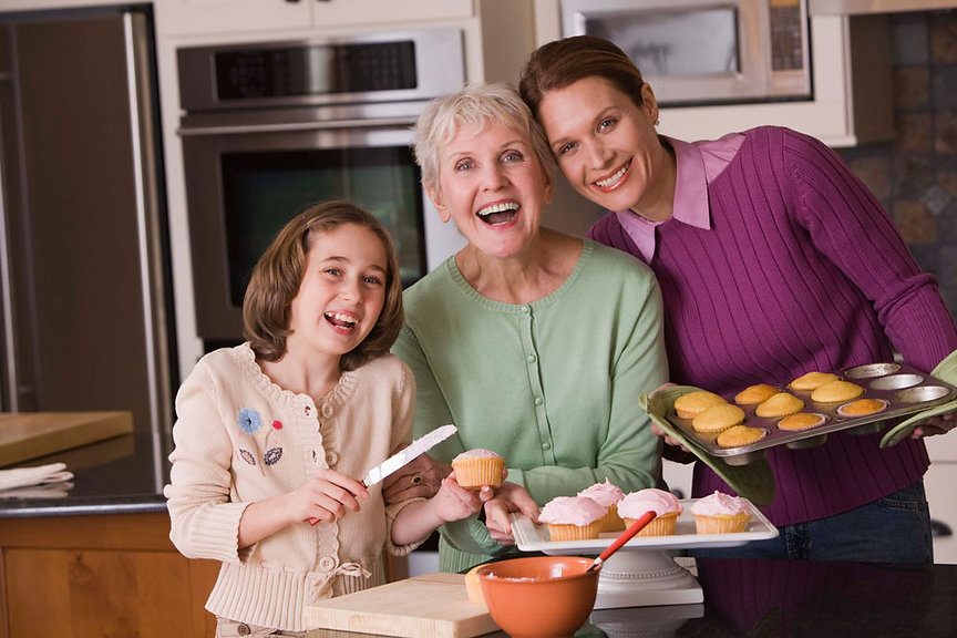 Shoals Home Healthcare patient enjoying being at home in the kitchen with her family, serving Florence Alabama area