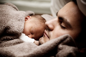 National Sleep Awareness Week, Father sleeping with newborn