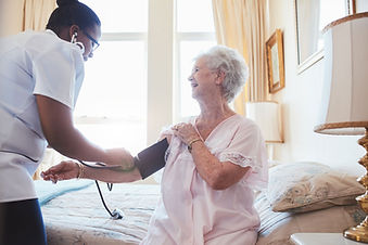 Shoals Home Healthcare nurse with patient at home, serving Florence, Alabama area