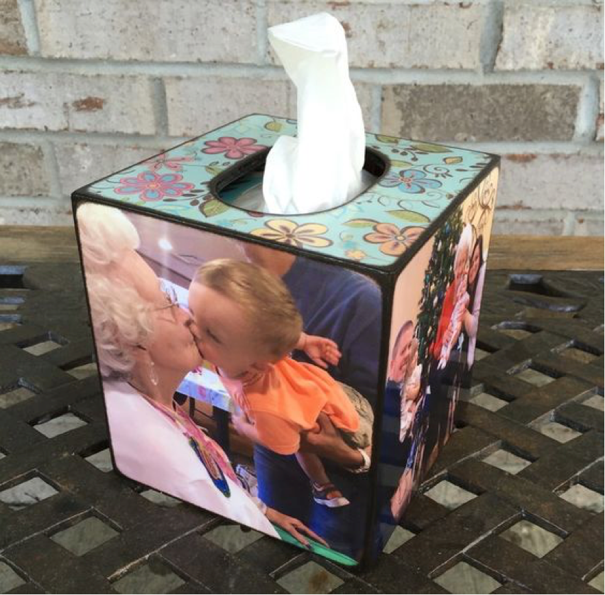 tissue box with pictures and designs on each side