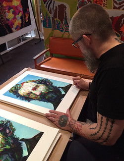 "Signing ""Cocker"" Prints"