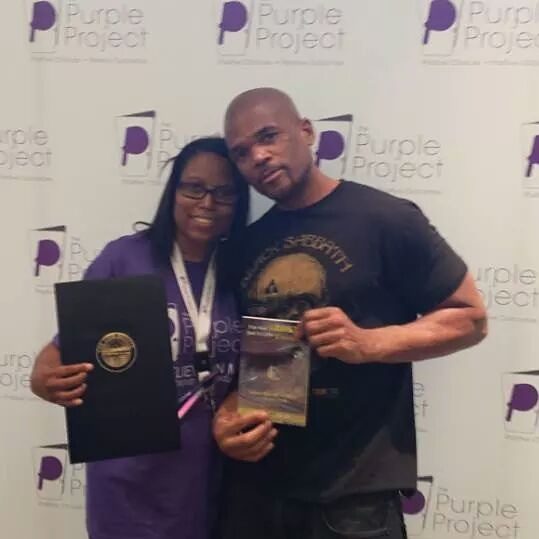LaTasha C. Watts & DMC with Award and Book